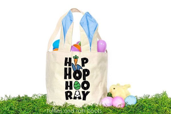 easter basket in green grass with eggs and hip hop hooray easter svg on front
