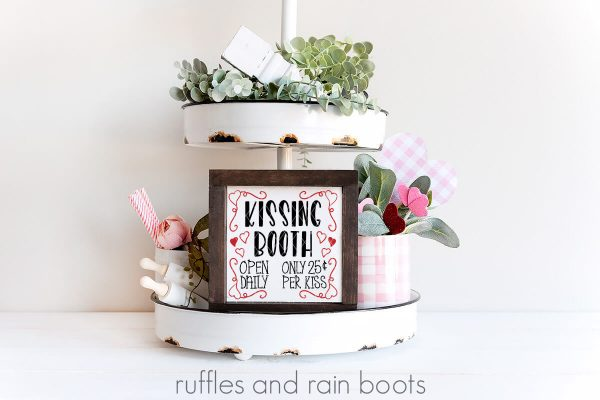 kissing booth svg displayed on white frame on a tiered tray