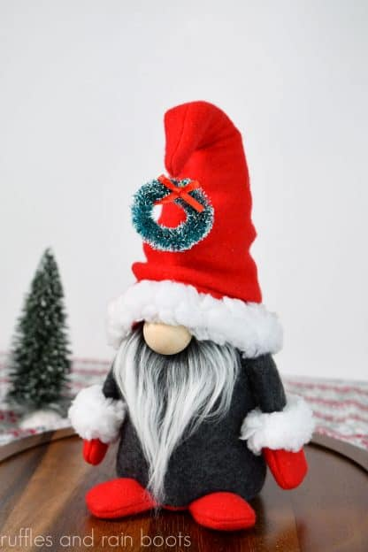 Christmas gnome pattern in gray and red on white background