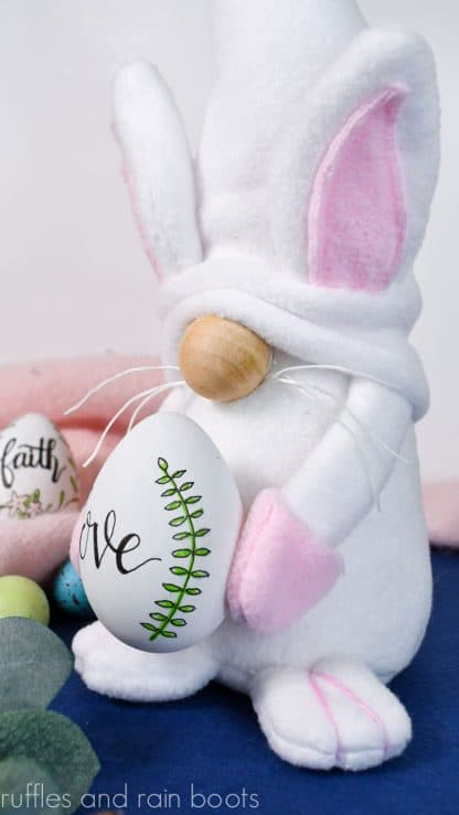 white and pink easter bunny gnome holding egg