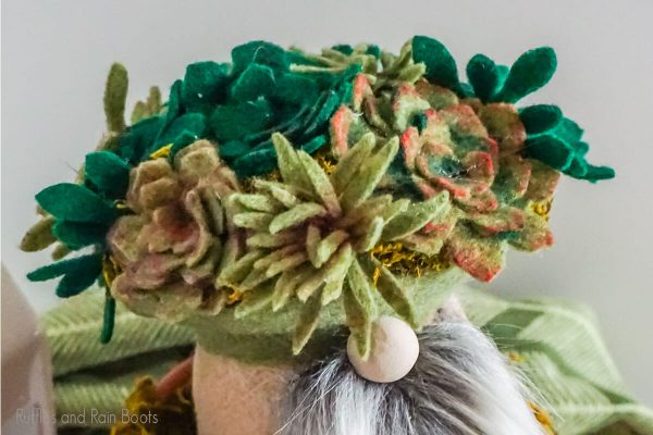 diy gnome with faux succulent cut files made into felt succulents on it's hat