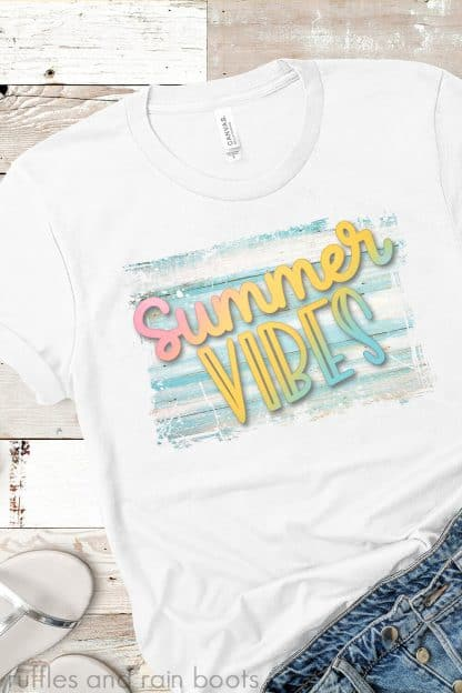 free colorful sublimation summer vibes design on white t shirt on wood background