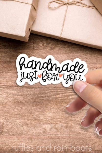 vertical image handmade just for you PNG sticker on wood background with craft paper packages