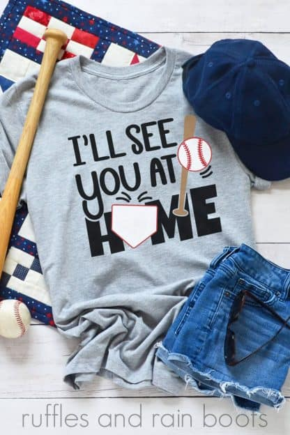 vertical image of vinyl on gray t shirt with baseball svg of ill see you at home base
