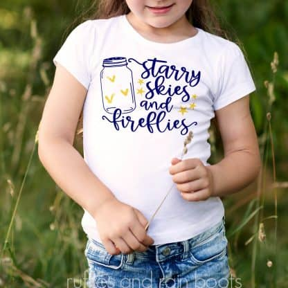 child with a shirt on which is the Summer SVG Starry Skies Fireflies