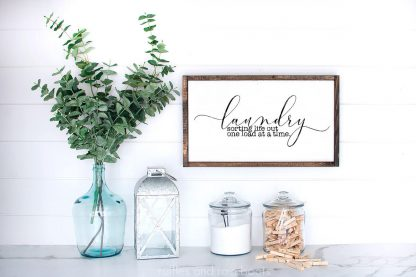 horizontal image of white wood sign with laundry svg in farmhouse style against a white wood background