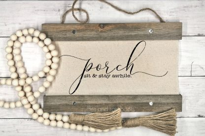 horizontal image of canvas wood hanging with porch sit and stay awhile svg with farmhouse beads on wood background