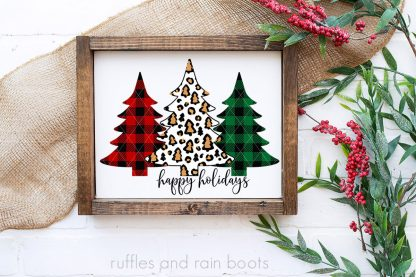 horizontal image of white and wood frame with red berry and green pine background with christmas tree sublimation in happy holidays