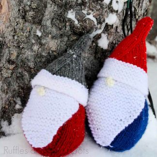 square image of two knitted gnomes using a free gnome knitting pattern from ruffles and rain boots