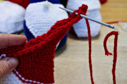 horizontal image of an up close view of a free gnome knitting pattern