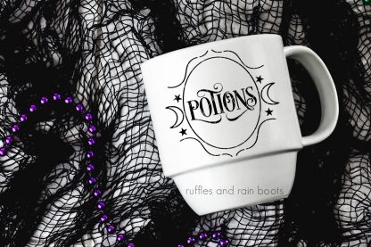 horizontal image of white mug with black potions SVG for halloween on black net background for halloween