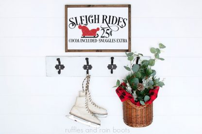 horizontal image of sleigh rides svg on Christmas sign hanging on white shiplap wall with ice skates and basket